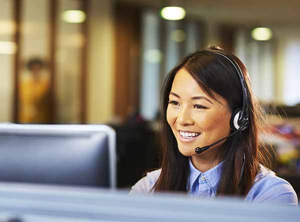 Woman at desk answering support call
